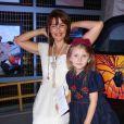 Rona Hartner et sa fille au Défilé Christophe Guillarmé collection printemps-été 2014 au Garage Renault République à Paris, le 25 septembre 2013.