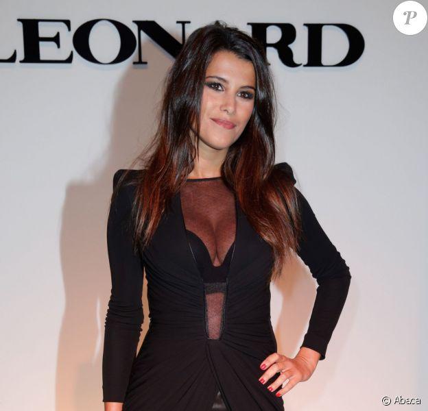 Karine Ferri assiste au défilé Leonard printemps-été 2014, dans la galerie sud est du Grand Palais. Paris, le 30 septembre 2013.