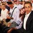 Nicolas Sarkozy et son épouse Carla Bruni au concert de leur ami Julien Clerc au festival de Ramatuelle, le 3 août 2013.