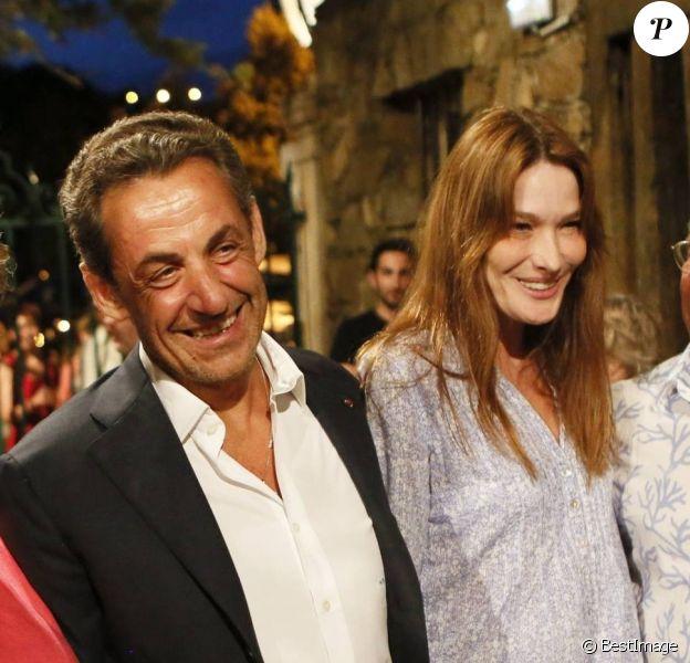 Nicolas Sarkozy et son épouse Carla Bruni-Sarkozy au concert de leur ami Julien Clerc au festival de Ramatuelle, le 3 août 2013.