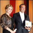 Catherine Deneuve et Jean Dujardin, prix d'interprétation pour The Artist, lors du Festival de Cannes 2011