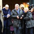 Alain Delon et Mireille Darc lors de l'hommage au cinéaste Georges Lautner, organisé à Paris en l'église Saint-Roch le 5 décembre 2013