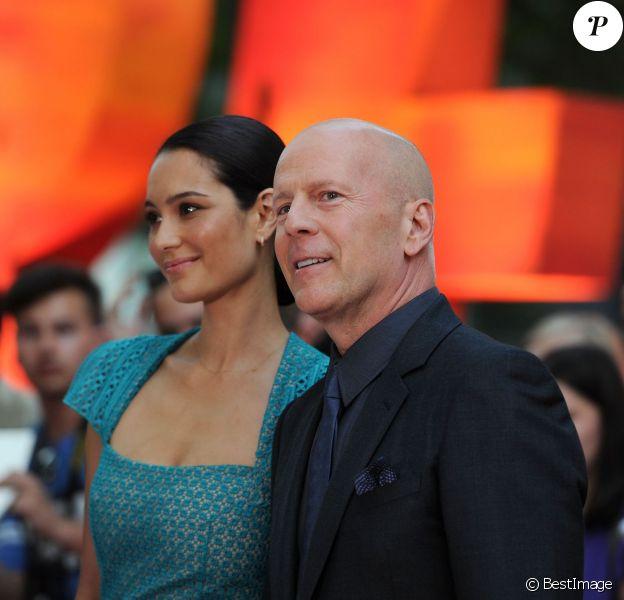 Bruce Willis et sa femme Emma Heming lors de la présentation du film Red 2 à Londres le 22 juillet 2013
