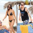 Exclusif - Prix Special - No web - No blog - Demi Moore et son nouveau petit-ami Sean - Demi Moore, son nouveau petit-ami Sean Friday, batteur du groupe Dead Sara, sa fille Rumer Willis et Jayson Blair en vacances a Cancun, le 29 decembre 2013. Demi Moore a encore craque pour un homme tres jeune. La mere, 51 ans, et la fille, 25 ans, frequentent donc des jeunes hommes de la meme generation !  Exclusive - For Germany Call For Price - No web - No blog - Demi Moore and daughter Rumer Willis continue to reconcile their relationship during a tropical vacay in Mexico with their young boyfriends on December 29, 2013. While 25-year-old Rumer snuggled with her former ex Jayson Blair, her hot-bodied 51-year-old cougar mom Demi More flaunted her bikini body in front of some eager older male callers but shrugged them choosing to share in public displays of affection with her much younger tattooed new unidentified beau. Despite the bizarre double date with boyfriends from the same generation, mother/daughter duo Demi and Rumer seemed to enjoy their time together while on holiday.29/12/2013 - Cancun