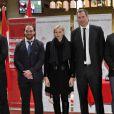 La princesse Charlene de Monaco entourée d'Andrew Sheridan, Mathieu Bonello, Ali Williams et Juan Martin Fernandez Lobe lors du 4e Challenge Sainte-Dévote de Rugby au Stade Louis II de Monaco, le 1er février 2014