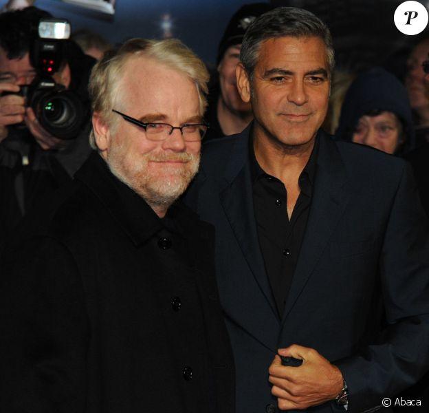 Philip Seymour Hoffman et George Clooney lors de l'avant-première des Marches du pouvoir à Londres le 19 octobre 2011