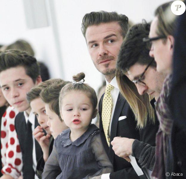 David Beckham et ses enfants Harper, Romeo, Cruz et Brooklyn sont venus soutenir Victoria Beckham lors de la présentation de sa collection automne/hiver 2014 à New York le 9 février 2014