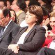 François Hollande et derrière discutant, Julie Gayet, lors de la convention d'investiture de François Hollande à la tête du PS pour l'élection présidentielle de 2012 à la Halle Freyssinet, Paris, le 22 octobre 2011.