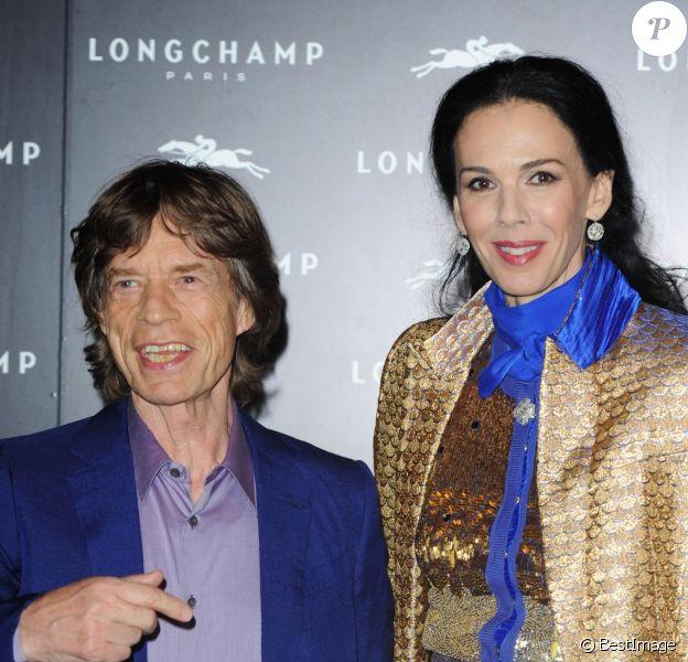 Mick Jagger et L'Wren Scott à l'inauguration de la boutique Longchamp à Londres, le 14 septembre 2013.
