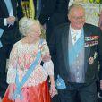 La reine Margrethe II de Danemark et le prince consort Henrik lors de la réception donnée le 12 mars 2014 au palais de Christiansborg pour les membres du gouvernement et parlementaires danois.