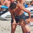 Raúl et sa petite dernière Maria en vacances sur la petite île de Formentera dans l'archipel des Baléares le 15 juin 2012