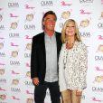 Olivia Newton et John Eastern pour le lancement de son show Summer Nights, à l'hôtel Flamingo de Las Vegas, le vendredi 11 avril 2014.