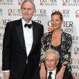 Nigel Planer, Kate Moss et Michael White lors de la cérémonie des Laurence Olivier Awards 2014 au Royal Opera House à Londres, le 13 avril 2014.
