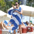 Katie Cassidy profite d'une belle après-midi sur une plage de Miami. Le 29 avril 2014.
