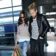 Zoe Saldana et son mari Marco Perego vont prendre un avion à l'aéroport JFK de New York, le 9 mai 2014.