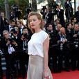 """Amber Heard à la montée des marches du film """"Deux jours, une nuit"""" lors du 67 ème Festival du film de Cannes le 20 mai 2014."""
