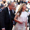 """Fawaz Gruosi et Amber Heard à la montée des marches du film """"Deux jours, une nuit"""" lors du 67 ème Festival du film de Cannes le 20 mai 2014."""