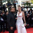 """Henri Leconte et son épouse Florentine à la montée des marches du film """"Deux jours, une nuit"""" lors du 67e Festival du film de Cannes le 20 mai 2014."""
