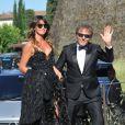 Renzo Rosso et sa compagne Arianna Alessi arrivent au Fort Belvedere pour assister au mariage de Kim Kardashian et Kanye West. Florence, le 24 mai 2014.