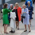 La princesse Claire de Belgique accueille le père Guy Gilbert lors de la communion des princes Nicolas et Aymeric de Belgique le 29 mai 2014 à l'église Sainte-Catherine de Bonlez.