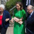 La princesse Claire de Belgique avec la reine Paola et le roi Albert II lors de la première communion des princes Nicolas et Aymeric de Belgique le 29 mai 2014 à l'église Sainte-Catherine de Bonlez.