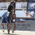 Marion Cotillard et son fils Marcel ont assisté à la belle victoire de Guillaume Canet lors du Prix VIP Riders Club of Cannes au Jumping de Cannes dans le cadre du Longines Global Champions Tour, le 12 Juin 2014