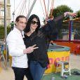 Ludovic Chancel (le fils de Sheila) et sa femme Sylvie Ortega Munos participent à l'ouverture de la fête des Tuileries 2014 à Paris, le 27 juin 2014.