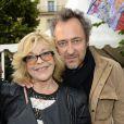 Nicoletta et son mari Jean-Christophe participent à l'ouverture de la fête des Tuileries 2014 à Paris, le 27 juin 2014.