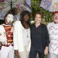 Thierry Fremont et sa compagne Gina participent à l'ouverture de la fête des Tuileries 2014 à Paris, le 27 juin 2014.