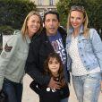 Smaïn avec sa compagne Sid, et sa fille accompagnée d'une amie, participent à l'ouverture de la fête des Tuileries 2014 à Paris, le 27 juin 2014.
