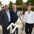 Claude Lelouch, Marcel Campion et Aurélie Filippetti participent à l'ouverture de la fête des Tuileries 2014 à Paris, le 27 juin 2014.