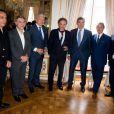 François Pirette, Salvatore Adamo, Didier Reynders, Michel Drucker, Eddy Merckx, Jacky Ickx, Eric-Emmanuel Schmitt, à l'occasion de la cérémonie de remise des insignes de commandeur de l'Ordre de la Couronne à Michel Drucker au palais d'Egmont à Bruxelles le 27 juin 2014.