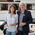 Estelle Denis et Raymond Domenech, au 2e Trophée de la Pétanque Gastronomique à Paris, le 27 juin 2014.