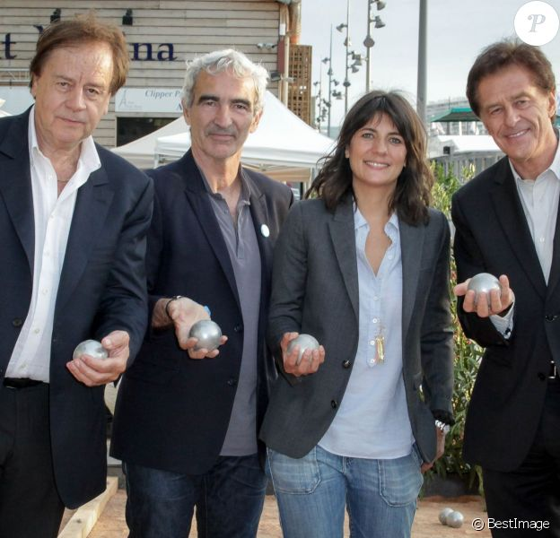Daniel Lauclair, Raymond Domenech, Estelle Denis et Henri Sannier, au 2e Trophée de la Pétanque Gastronomique à Paris, le 27 juin 2014.