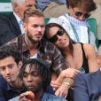 M. Pokora et Scarlett Baya dans les tribunes de Roland Garros. Paris, le 2 juin 2014.
