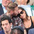 M. Pokora et sa petite amie Scarlett Baya dans les tribunes de Roland Garros. Paris, le 2 juin 2014.