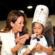 Brooke Burke avec ses enfants Shaya et Heaven, lors de l'événement Junior Chef Academy à Culver City, Los Angeles, le 15 juillet 2014