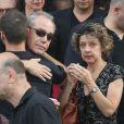 Exclusif - Obsèques de Caroline Beaune, au cimetière du Père-Lachaise à Paris, le 30 juillet 2014. Sa famille et toutes les doublures des plus grandes voix internationales étaient là pour lui rendre un dernier hommage. Caroline Beaune, filleule de Jean-Paul Belmondo, décédée le 24 juillet dernier, était actrice et doublure des voix françaises de Gillian Anderson (Dana Scully dans X-Files) et Felicity Huffman (Lynette Scavo dans Desperate Housewives).