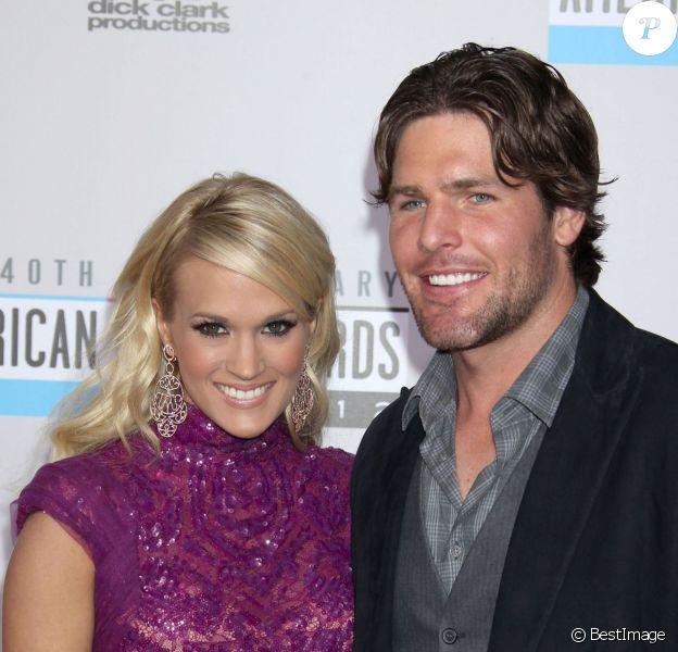 "Carrie Underwood et son mari Mike Fisher lors du 40e anniversaire des ""American Music Awards"" à Los Angeles. Le 18 novembre 2012."