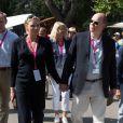 La princesse Charlene de Monaco, enceinte de six mois, et le prince Albert II de Monaco le 14 septembre 2014 au dernier jour de l'Evian Championship de golf, remporté par Hyo Joo Kim.