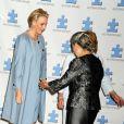La princesse Charlene de Monaco, enceinte de son premier enfant, accueillie par Ban Soon-taek, épouse de Ban Ki-moon, à son arrivée à l'hôtel Hilton de New York le 25 septembre 2014 pour le 7e Focus mondial annuel sur l'autisme.