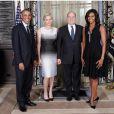 La princesse Charlene, enceinte, et le prince Albert II de Monaco étaient mardi 23 septembre 2014 les invités de Barack et Michelle Obama lors d'une réception au Waldorf Astoria à New York en marge du Sommet des chefs d'Etat sur le climat à l'ONU.   Image : Facebook du palais princier.