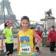"""La jolie Fabienne Carat lors de la course """"La Parisienne 2014"""" pour la lutte contre le cancer, au Champs de Mars à Paris, le 14 septembre 2014"""
