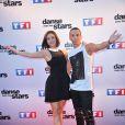 """Nathalie Péchalat et Grégoire Lyonnet lors du photocall de présentation de la nouvelle saison de """"Danse avec les Stars 5"""" à Paris, le 10 septembre 2014."""