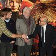 """Stanley Tucci, Donald Sutherland, Liam Hemsworth, Sam Claflin au photocall du film """"The Hunger Games : Mockingjay - part 1"""" (Hunger Games - La Révolte : Partie 1) à Londres, le 9 novembre 2014."""