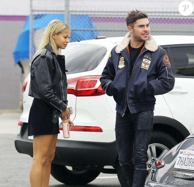 Exclusif - Zac Efron et sa nouvelle petite amie Sami Miro regardent une Mustang chez un concessionnaire automobile à Cerritos, le 11 novembre 2014.