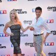 """Tonya Kinzinger et Maxime Dereymez - Photocall de présentation de la nouvelle saison de """"Danse avec les Stars 5"""" au pied de la tour TF1 à Paris, le 10 septembre 2014."""