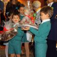 Les jumeaux Luis et Alfonso et leur soeur Eugenia, enfants de la princesse Margaritaet du prince Louis de Bourbon, le 22 novembre 2014 à Madrid lors de la vente caritative Rastrillo Nuevo Futuro, au profit de l'association qui vient en aide aux orphelins.