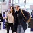 George et Amal Clooney à l'aéroport d'Heathrow à Londres en direction des Etats-Unis le 27 novembre 2014