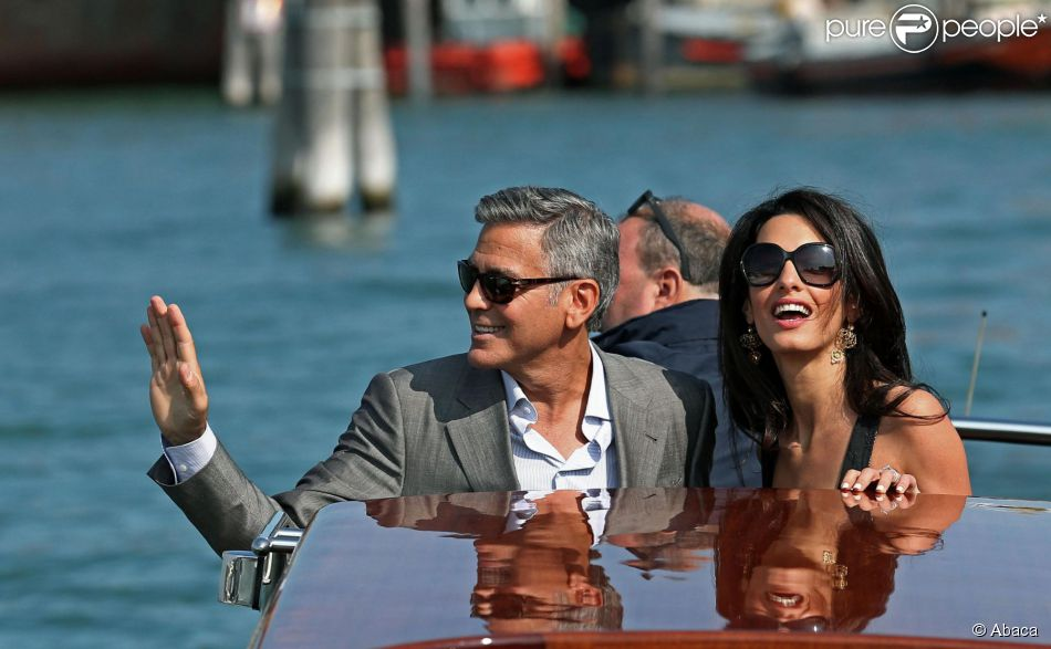 George Clooney et sa fiancée Amal Alamuddin arrivent à Venise le 26 septembre 2014 où ils vont célébrer leur mariage, prévu lundi 29 septembre.